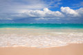 Tropical white sand beach and blue sky. Royalty Free Stock Photo
