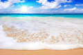Tropical white sand beach and blue sky pretty scenic features aquamarine aquarium water with clouds Stock Images