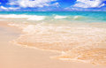 Tropical white sand beach and blue sky pretty scenic features aquamarine aquarium water with clouds Stock Photography