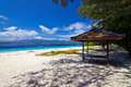 Tropical white sand beach sea and sky with clouds gili meno lombok indonesia Royalty Free Stock Photography
