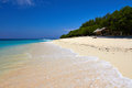 Tropical white sand beach sea and sky with clouds gili meno lombok indonesia Stock Photo