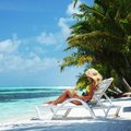 Tropical woman on lounge Royalty Free Stock Images