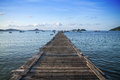 Tropical wooden pier in turquoise sea Royalty Free Stock Photo