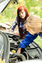 Trouble with the car engine in the road Royalty Free Stock Image