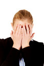 Troubled business woman covering her face with hands Royalty Free Stock Photo