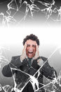 Troubled businessman with headache screaming in pain behind brok broken glass stressed man suffering from migraine texture concept Royalty Free Stock Images