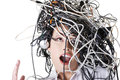 Troubled shocked businesswoman with cables on head Stock Image