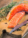 Trout and rosemary on a wooden board Stock Image