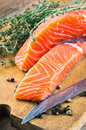 Trout and rosemary on a wooden board Royalty Free Stock Photo