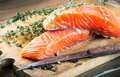 Trout and rosemary on a wooden board Stock Images