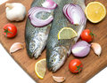 Trout, vegetables and lemon on a cutting board Stock Image