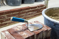 Trowel bricks cement building walls Stock Photo