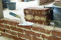 Trowel bricks cement building walls Stock Image