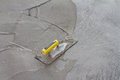 Trowel on fresh concrete on construction site Royalty Free Stock Photo