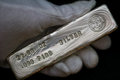 Troy ounce silver bullion bar in hand held this is a poured and stamped ingot Stock Photo