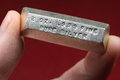 Troy ounce silver bullion bar held between fingers poured ingot Stock Photos