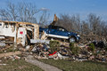 Truck atop destroyed home after tornado blue sitting remains of december in garland tx Stock Photos