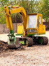 Truck backhoe soil excavation in construction site Stock Photography