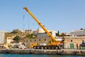 Truck crane in shipyards harbor of malta clear weather on a background blue sky Royalty Free Stock Photos