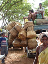 A truck crowded with people and baskets returns home orissa india nov after day at the weekly market on nov in orissa india Royalty Free Stock Photos