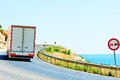 Truck on a dangerous road along the sea Royalty Free Stock Photography