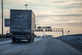 Truck on dirty winter ring road in the evening Royalty Free Stock Photo