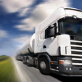 Truck driving on country-road/ Stock Photography