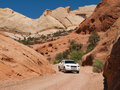 Truck driving through narrow desert canyon Stock Photo