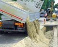 Truck in the excavation after laying of underground electric cab cables and telecom cables optical fibre Stock Photo