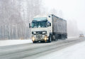 Truck goes on winter road Royalty Free Stock Photo