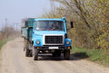 Truck on the gravel road agriculture a is Royalty Free Stock Photography