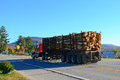 Truck hauling logs loaded logging pulp past lake pleasant ny Royalty Free Stock Image