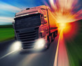 Truck on highway cargo speeding at sundown Royalty Free Stock Photos