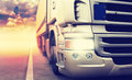 Truck on highway cargo speeding at sundown Royalty Free Stock Photography