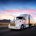 Truck and highway at sunset transportation background Royalty Free Stock Photos