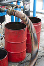 Truck Hoses for fuel station, pumps, oil barrels Stock Photo