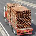 Truck loaded with plastic pipes fully of various diameters Stock Photography