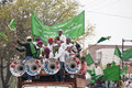 Truck loads of loud celebrating young muslims in agra india circa february the islam green dominates the picture combination with Stock Image