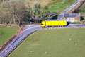 Truck lorry and trailer yellow transport on rural narrow road Royalty Free Stock Image