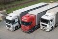 Truck parking three trucks near railway Stock Image