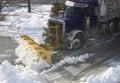 Truck Plowing Snow on Street