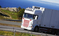 Truck on scenic freeway clean white driving a route close up view from the side Stock Photography