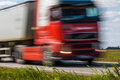 Truck transport on the road with motion blur. Blurred image back Royalty Free Stock Photo