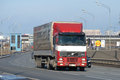Truck Volvo FH12 with a tilted semitrailer on Pulkovskoe highway in the spring afternoon