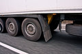 Truck wheels in motion a view of left side of lorry with a speeding driving on highway Royalty Free Stock Photo