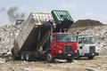 Trucks Dumping Waste Royalty Free Stock Photo