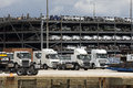 Trucks and luxury cars await export from docks UK Royalty Free Stock Photo