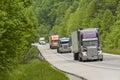 Trucks on mountain highway horizontal shot of Royalty Free Stock Photo