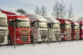 Trucks in a row white and red color parked outdoors winter time Stock Images