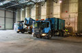 Trucks unloading garbage at recycle plant Stock Photo